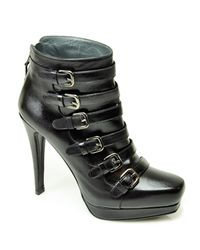 Stuart Weitzman - Iron Lady - Black Leather Buckled Bootie - Lyst