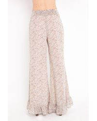 Nasty Gal - Natural Ditsy Flare Pants - Beige - Lyst