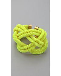 Noir Jewelry | Yellow Shaka Neon Knot Bracelet | Lyst