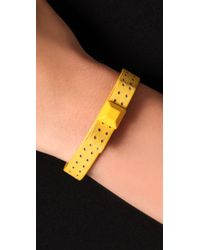 Juicy Couture - Yellow Studded Leather Bow Cuff - Lyst