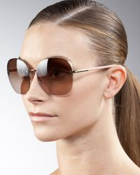 Prada - Brown Oversize Rimless Sunglasses - Lyst