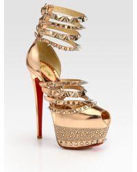 cb62b61b955 Christian Louboutin. Women s Isolde Studded Metallic Leather Platform  Sandals