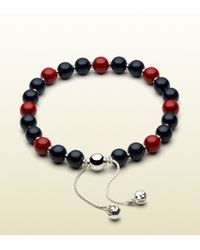 Gucci | Metallic Bracelet With Blue And Red Wooden Beads for Men | Lyst