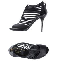 Gucci | Black Gia Leather Spectator Booties | Lyst