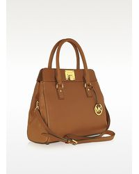 e54d53bca1bb Lyst - Michael Kors Astrid Large Leather Satchel in Brown