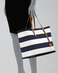 2e50b0558a38 ... switzerland lyst michael michael kors jet set stripe medium travel tote  in blue 61c01 1f906