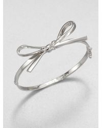 kate spade new york | Metallic Bow Bangle Braceletsilver | Lyst