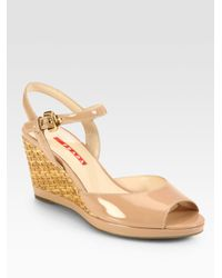 9ab56e00d91 Lyst - Prada Patent Leather Wicker Wedge Sandals in Natural