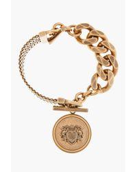 Givenchy - Metallic Vintage Gold Crest Pendent Bracelet - Lyst