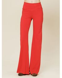 Nightcap | Red Smocked Basic Flare Trousers | Lyst