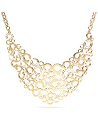 COACH - Metallic Pierced Op Art Bib Necklace - Lyst