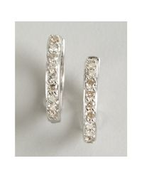 Sydney Evan | White Gold and Diamond Huggy Small Hoop Earrings | Lyst