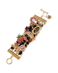 Betsey Johnson - Multicolor Antique Goldtone Paris Cat Multicharm Wide Toggle Bracelet - Lyst