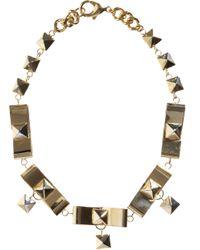 Fallon - Metallic Brass Bow Choker - Lyst