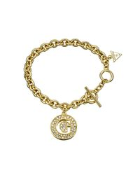 Guess | White G Girl Small G Disc Gold Plated Bracelet | Lyst