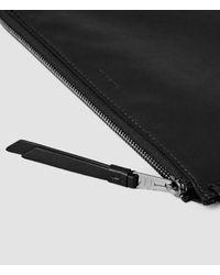 AllSaints - Black Fleur De Lis Large Leather Pouch - Lyst