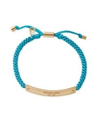 Michael Kors | Blue Goldtone Logo Plaque and Turquoise Macrame Cord Id Bracelet | Lyst