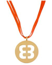 Betsey Johnson | Orange Antique Gold-tone Fuchsia Faux-leather Emblem Pendant Necklace | Lyst