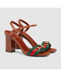 9272a96b142 Lyst - Gucci Leather Mid-heel T-strap Sandal in Brown