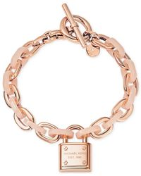 Michael Kors | Pink Rose Gold-Tone Padlock Logo Bracelet | Lyst