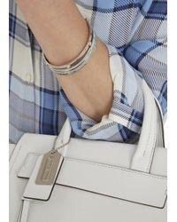 COACH - Metallic Silver Plated Swarovski Embellished Bracelet Set - Lyst