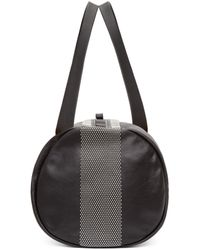 Alexander McQueen | Black Studded Leather Duffle Bag for Men | Lyst