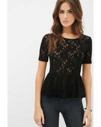 24bc73dd9a Lyst - Forever 21 Textured Lace Peplum Top in Black
