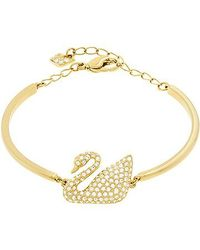 Swarovski | Metallic Swan Bangle | Lyst