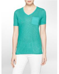 Calvin Klein | Green Jeans Solid V-neck High-low Slub T-shirt | Lyst