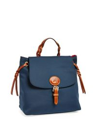 Dooney & Bourke | Blue Nylon Flap Backpack | Lyst