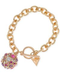 Guess | Metallic Gold-tone Fireball Pink And Lilac Crystal Charm Bracelet | Lyst