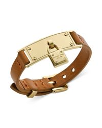 Michael Kors - Goldtone and Brown Leather Padlock Charm Adjustable Bracelet - Lyst