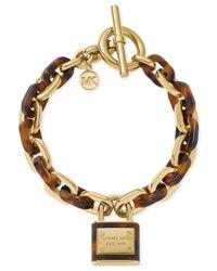 Michael Kors - Metallic Gold-Tone Tortoise Padlock Charm Toggle Bracelet - Lyst