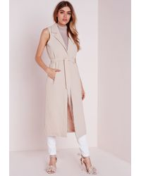 69428ffb0f70d1 Missguided Sleeveless Belted Longline Duster Coat Nude in Natural - Lyst