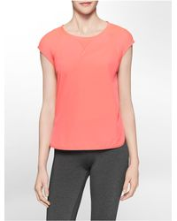 Calvin Klein - Orange White Label Performance Mesh Detail High Low Cap Sleeve Top - Lyst