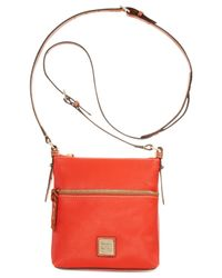 Dooney & Bourke | Orange Pebble Letter Carrier | Lyst