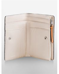 Calvin Klein   Orange Kelsey Pebble Leather French Clutch   Lyst