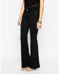 Free People | Clean Flare Jean In Black | Lyst