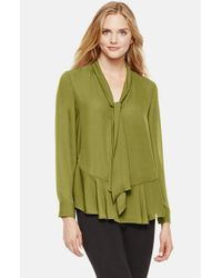 Vince Camuto | Green Tie Neck Ruffle Hem Blouse | Lyst