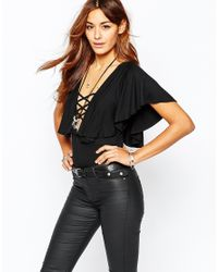 Missguided - Black Lace Up Body With Fluted Sleeve - Lyst