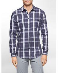 14b5c400e63 Calvin Klein. Men s Blue White Label Ck One Slim Fit Large Check Dobby Shirt