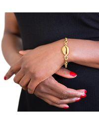 Rokus - Metallic Cowrie Convertible Earring Bracelet - Lyst
