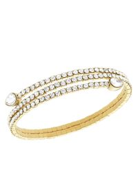 Swarovski | Metallic Goldtone And Crystal Twisted Bangle Bracelet | Lyst