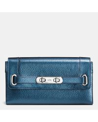 COACH | Blue Swagger Wallet In Metallic Pebble Leather | Lyst