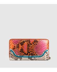 b83aff6c14decb Lyst - Gucci Bamboo Tassel Python Zip Around Wallet in Natural