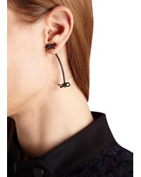 Fallon | Black Forget Me Knot Earrings | Lyst
