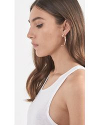 Pamela Love - Metallic Eagle Claw Earring - Lyst