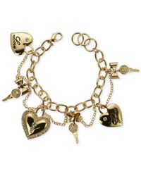 Guess - Metallic Gold-Tone Heart And Key Charm Bracelet - Lyst