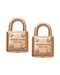 Michael Kors | Metallic Rose Goldtone Logo Padlock Stud Earrings | Lyst