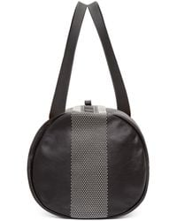 Alexander McQueen - Black Studded Leather Duffle Bag for Men - Lyst